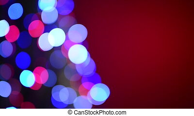 Defocused Christmas tree blinking lights that become bigger...