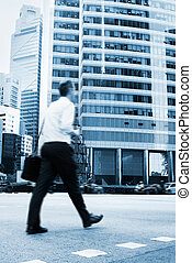 Singapore businessman - Unidentified businessman crossing...