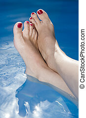 Woman Feet in the Water - Woman Feet with nails painted red...