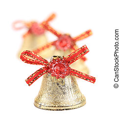 Christmas jingle bells with red ribbon. Blurred background.