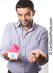 Young Man presenting Miniature House and Key - Young...