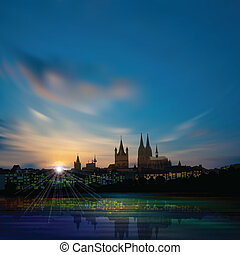 abstract background with silhouette of koln and sunset -...