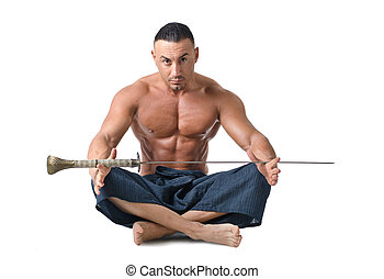 Muscular man sitting on the floor with japanese sword -...