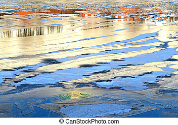 floating thin ice on the river - illuminated by the sun,...