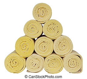 Rolled up spa towels on white