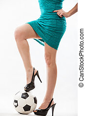 Hispanic soccer mom stepping on ball