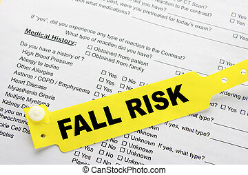 Fall Risk With Hospital Paperwork - A yellow fall risk...