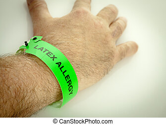 Latex Allergy Wrist Bracelet - A hand with a green latex...