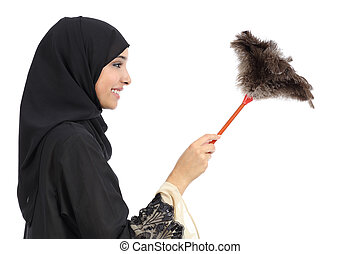 Profile of an arab woman cleaning with a duster clean...