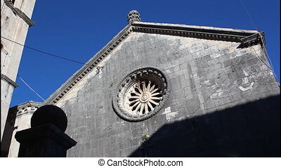 Perast, church and bell tower, pan left