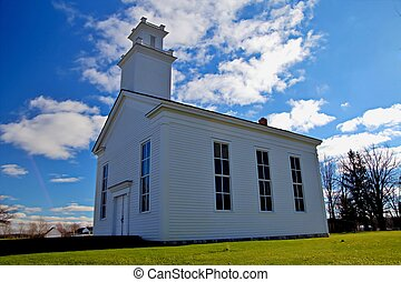 Sunday Best - Historical country church set against a...