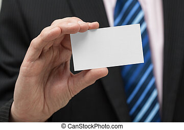 Business card closeup - A close up of a man with a business...