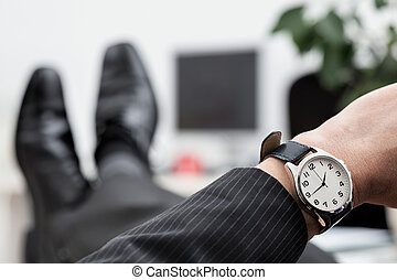 Businessman's watch closeup - A close up of a businessman's...