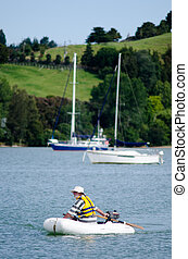 Man sails an inflatable boat - Man sails a rubber inflatable...