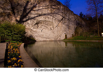 dying lion monument in Lucern Switzerland twilight with...