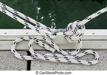Mooring rope - Two mooring ropes tied around steel anchor