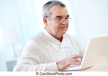 Mature man typing