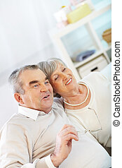 Resting at home - Portrait of a happy senior couple having...