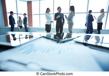 Business communication - Business people interacting in...