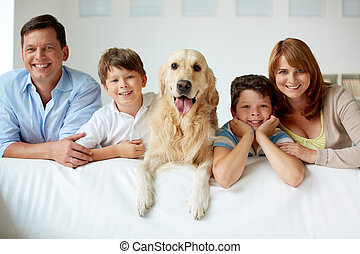 Big family - Portrait of happy family with their pet looking...