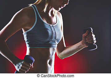 Physical training - Body of slim female in activewear doing...
