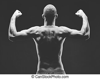 Male power - Image of shirtless man with raised arms in...