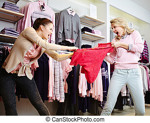 Shopping violence - Image of two aggressive girls fighting...
