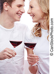 Toasting for love - Happy and romantic couple holding...