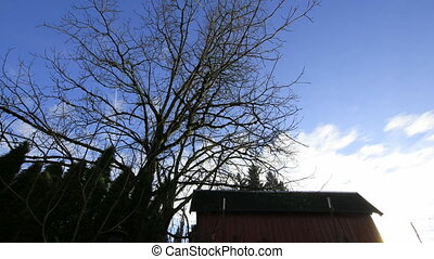 Moving White Clouds Timelapse with Blue Sky and Red Barn in...