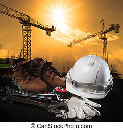 helmet and construction equipment with building and crane...