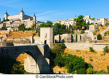 Puente de Alcantara in Toledo Spain - day view of Puente de...