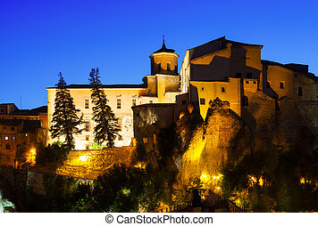 Night view of medieval houses on rocks - Night view of...