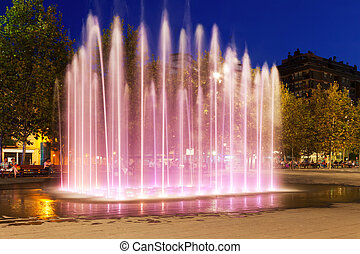 Fountain at town square in night. Sant Adria de Besos - View...