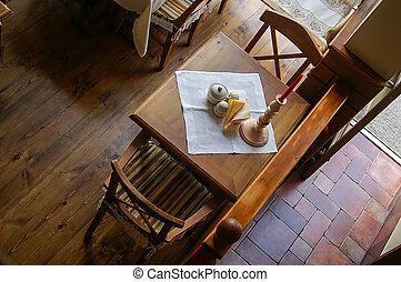 Overhead view of a rustic wooden cafe table for two, set...