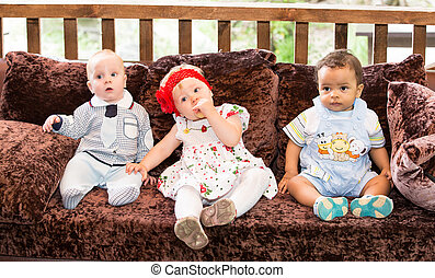 Small three children: black american, caucasian boys and...