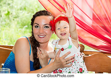 Happy birthday girl child year-old with mother in park at...