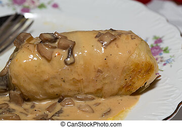 cabbage stuffed roll with mushroom sauce
