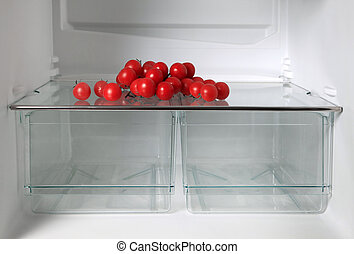 Empty refrigerator with fresh tomatos