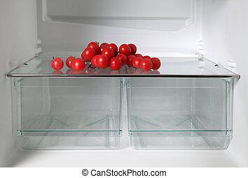Empty refrigerator with fresh tomatos