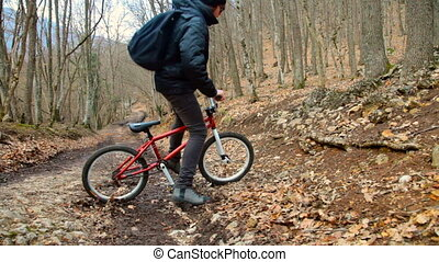 Teen boy rides a bicycle - Teen boy rides a bicycle in the...