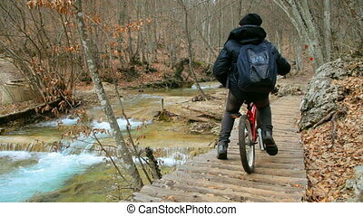 cyclist rides bike on the trail - a cyclist rides bike on...