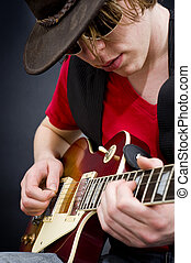Blues musician - A blues guitarist playing a tune on his...