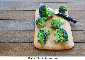 broccoli florets on the kitchen board, food closeup