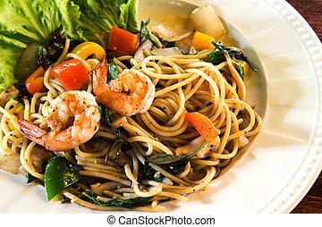 Spaghetti, shrimp, lettuce, tomato and pepper in white dish...