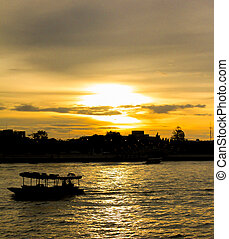 Boat in chaopraya river when sunset