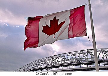 Oh Canada! - Canadian flag and in the background are the...