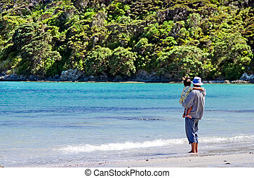 Landscape of Karikari Peninsula New Zealand - Man hold his...