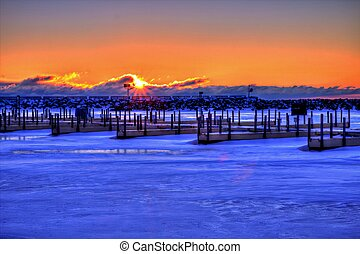 Fisherman's Sunrise - Ice Fishermen enjoy a Great Lakes...