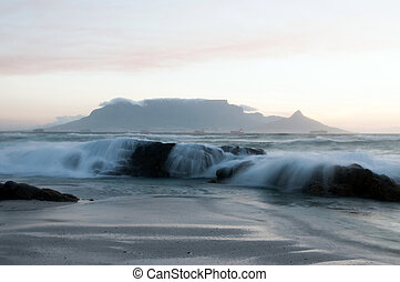 Table Mountain - South Africa - Rocks and waves with Table...