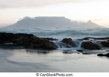 Majestic Table Mountain - Rocks and waves with Table...